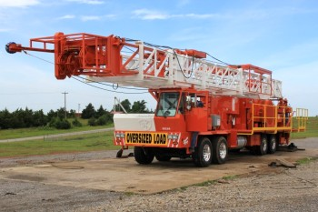 Service King Manufacturing SK 375 Carrier mount rig with 96 foot workover derrick.