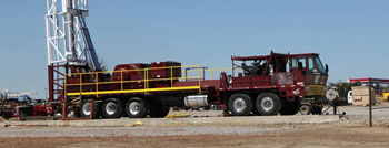 Service King Manufacturing SK 675 Carrier mount rig with 109 foot workover derrick.