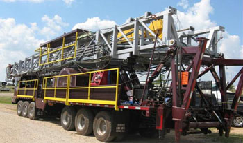 Service King Manufacturing SK 775 Carrier mounted Oil and gas rig.